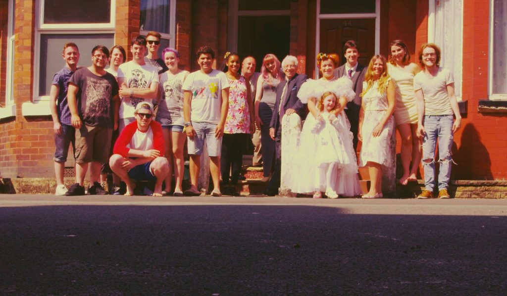 The cast of our short film pose for a publicity photograph on the street