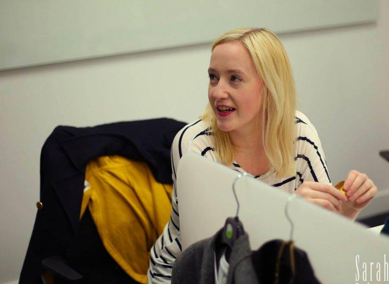 Costume designer Olivia prepares her materials on set