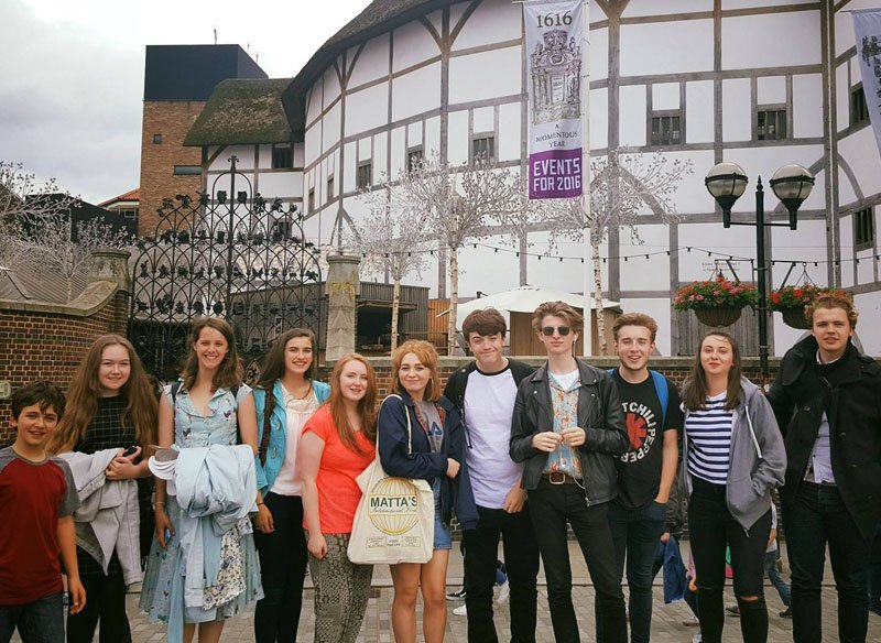 Members of our young actors company stand outside Shakespeare's Globe Theatre